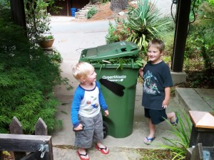 Leaf-eating monster robot composting cart and kids.